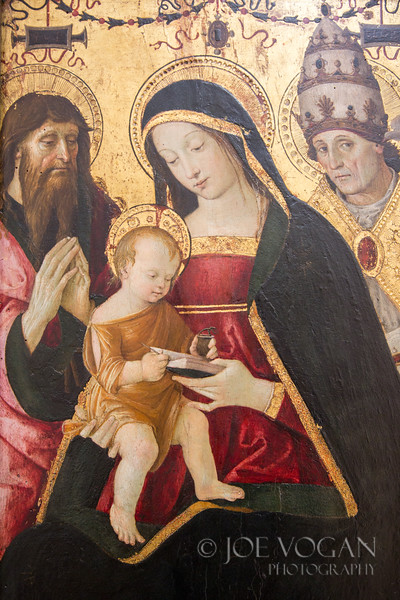 Madonna and Child with Saint Jerome and Saint Gregory the Great, by Pinturicchio, circa 1502-1508, oil and tempera on wood.  Louvre Museum, Paris, France
