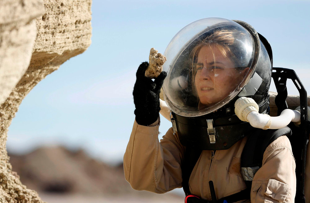 . Csilla Orgel, a geologist with Crew 125 EuroMoonMars B mission, collects geologic samples for study at the Mars Desert Research Station (MDRS) outside Hanksville in the Utah desert March 2, 2013.  REUTERS/Jim Urquhart