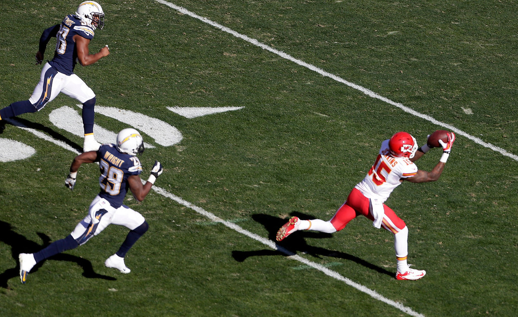 . Kansas City Chiefs wide receiver A.J. Jenkins, right, hauls in a pass as San Diego Chargers cornerback Shareece Wright (29) and strong safety Marcus Gilchrist, top left, can\'t catch him during the first half in an NFL football game Sunday, Dec. 29, 2013, in San Diego. (AP Photo/Gregory Bull)