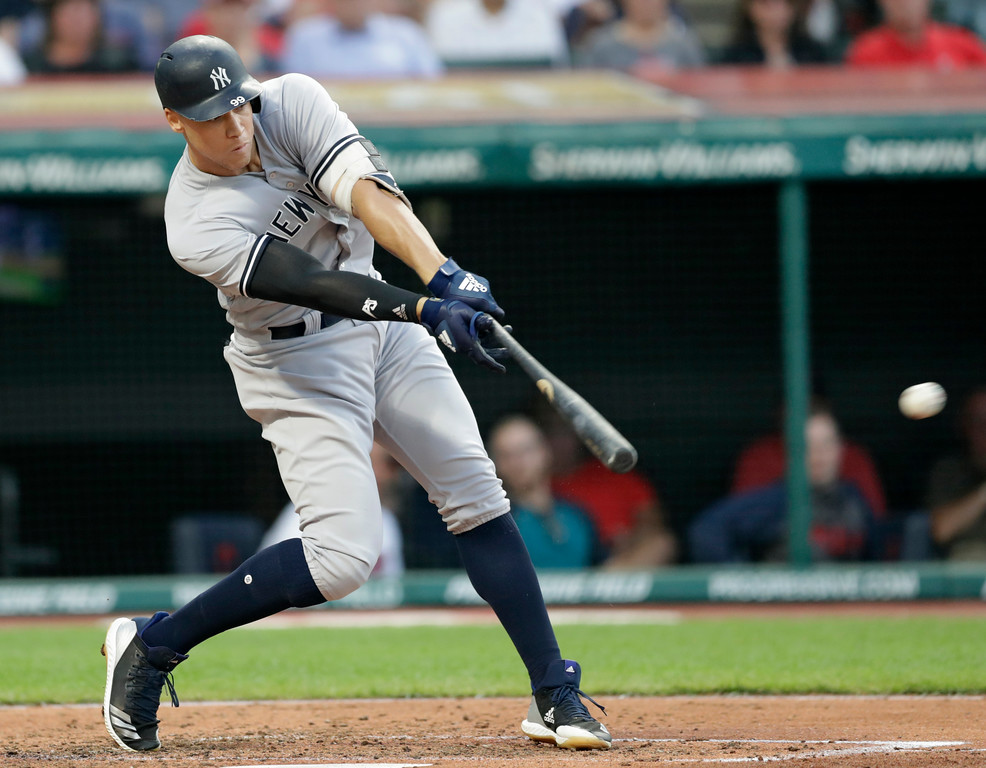. New York Yankees\' Aaron Judge hits a double in the fifth inning of a baseball game against the Cleveland Indians, Thursday, July 12, 2018, in Cleveland. (AP Photo/Tony Dejak)
