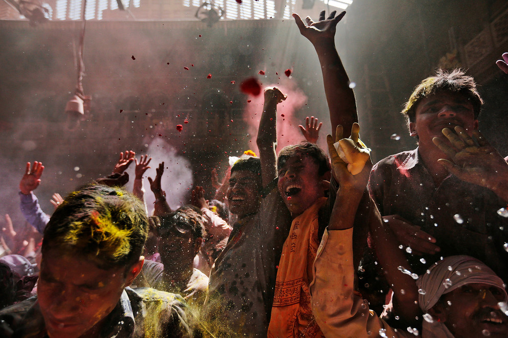 . Hindu devotees celebrate seeing the deity of Krishna inside Banke Bihari temple, dedicated to Lord Krishna, during Holi festival celebrations in Vrindavan, India, Tuesday, March 26, 2013. Holi, the festival of colors celebrates the arrival of spring. (AP Photo/Kevin Frayer)