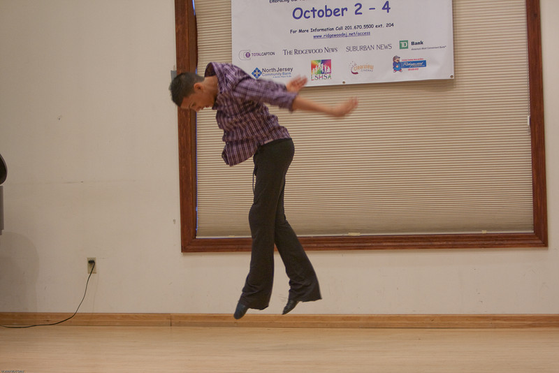 (1) Slug #: W 24464; (2) Ridgewood, NJ; (3) 10/03/09; (4) Ridgewood Community Access Network Presents Access Ridgewood on 10/3/2009; (5) Mark Travis Rivera, founder and performing member of the Hand-Cap Dance Company, on stage at Access Ridgewood on 10/3/2009; (6) W.H. GRAE for the Ridgewood News.