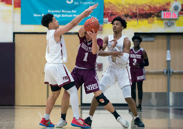 12/30/19 Wesley Bunnell | Staff New Britain boys basketball vs Naugatuck on Monday night at NBHS. Justice Carter (0) and Tahmen Dupree (5) double team a Naugatuck player.