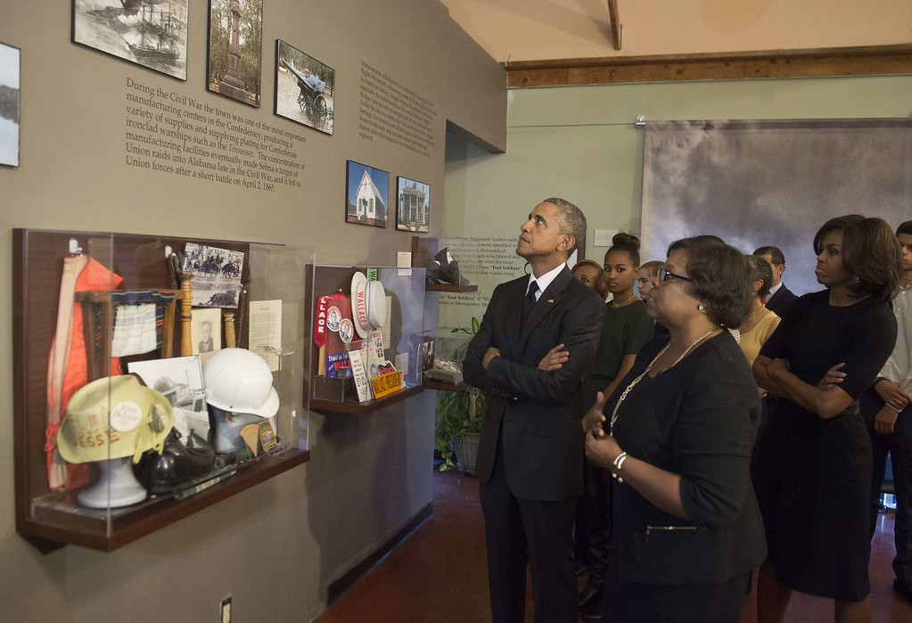 ". US President Barack Obama, First Lady Michelle Obama and daughters Malia and Sasha tour the National Voting Rights Museum to mark the 50th Anniversary of the Selma to Montgomery civil rights marches in Selma, Alabama, on March 7, 2015. US President Barack Obama rallied a new generation of Americans to the spirit of the civil rights struggle, warning their march for freedom ""is not yet finished.\"" In a forceful speech in Selma, Alabama on the 50th anniversary of the brutal repression of a peaceful protest, America\'s first black president denounced new attempts to restrict voting rights. AFP PHOTO/ SAUL  LOEB/AFP/Getty Images"