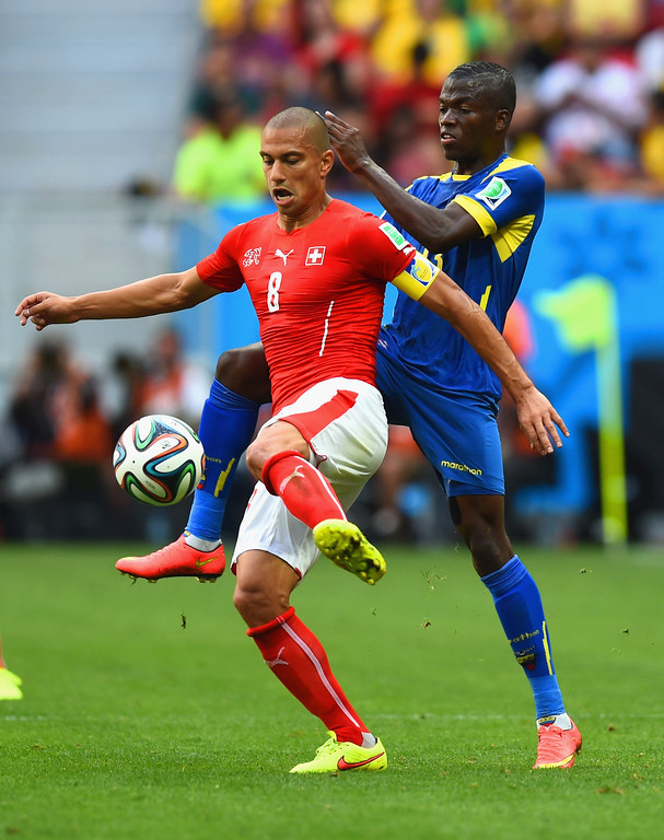 . Gokhan Inler of Switzerland controls the ball against Enner Valencia of Ecuador during the 2014 FIFA World Cup Brazil Group E match between Switzerland and Ecuador at Estadio Nacional on June 15, 2014 in Brasilia, Brazil.  (Photo by Stu Forster/Getty Images)