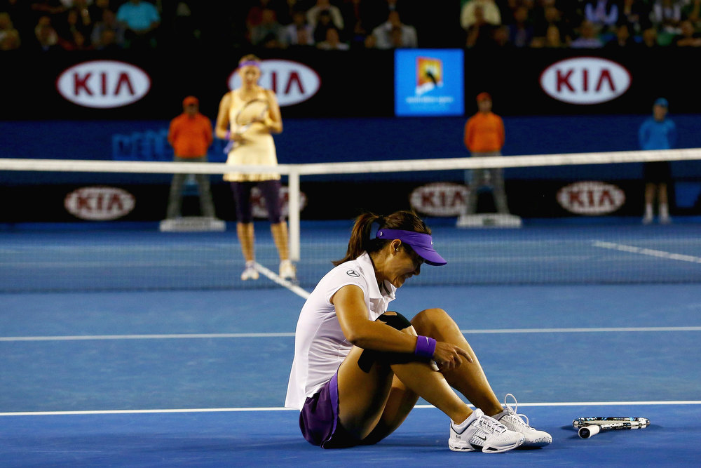 . China\'s Li Na tries to get up after falling during her match against Victoria Azarenka of Belarus in the women\'s final at the Australian Open tennis championship in Melbourne, Australia, Saturday, Jan. 26, 2013. (AP Photo/Ryan Pierse,Pool)