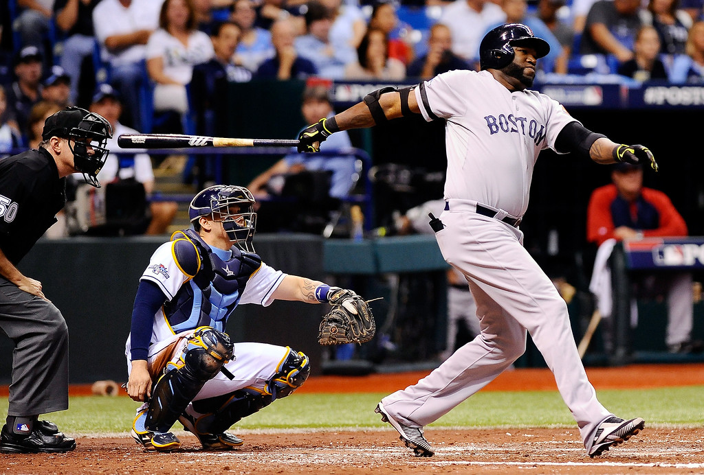 . David Ortiz #34 of the Boston Red Sox hits a single in the fourth inning against the Tampa Bay Rays during Game Four of the American League Division Series at Tropicana Field on October 8, 2013 in St Petersburg, Florida.  (Photo by Brian Blanco/Getty Images)