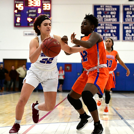 3/5/2019 Mike Orazzi | Staff St. Paul Catholic High School's Morgan Kolb (22) and Bloomfield's Sanaa Woodard (12) during the Class S Quarterfinals Girls Basketball Game Tuesday night in Bristol.