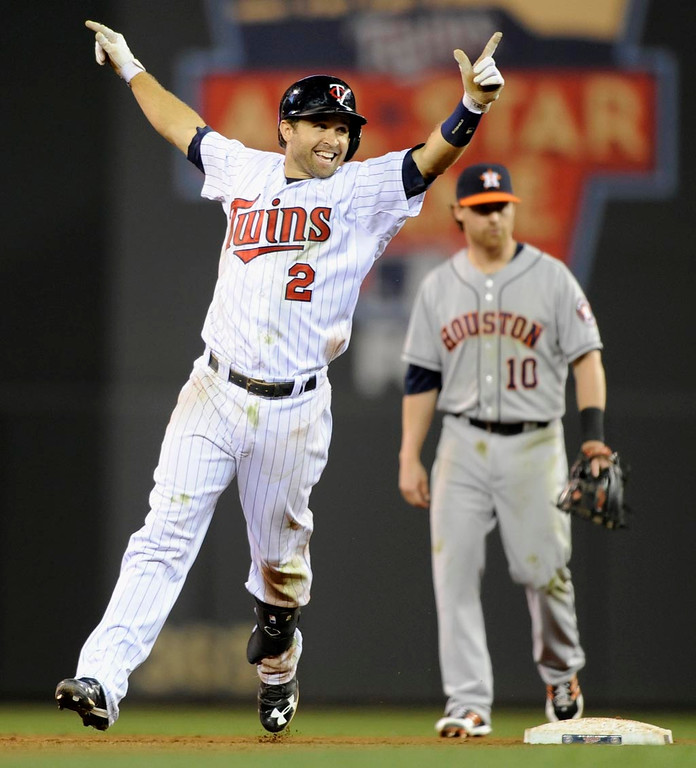 . Brian Dozier celebrates driving in the winning run. (Photo by Hannah Foslien/Getty Images)