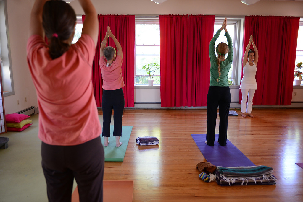 . Tania Barricklo-Daily Freeman Shawn Harrison of Mudita Yoga at 243  Fair St.  in Kingston leads a morning yoga class.