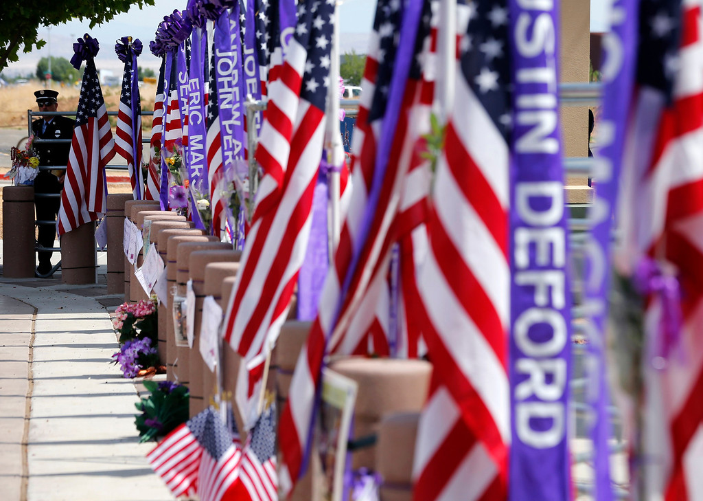 . A firefighter waits at the entrance of a memorial for the fallen members of Prescott Fire Department\'s Granite Mountain Hotshots team in Prescott Valley, Arizona July 9, 2013. 30. REUTERS/Mike Blake