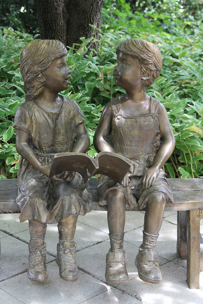 loved this bronze piece - boy and girl sharing a book