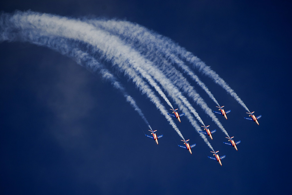 ". Jets of the ""The Patrouille de France\"" perform during the first day of AIR14 air show on August 30, 2014 in Payerne, western Switzerland.  AFP PHOTO / FABRICE COFFRINI/AFP/Getty Images"