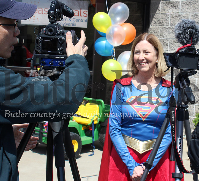 Harold Aughton/Butler Eagle: Patty Braendle, director of children programs for EasterSeals, address the media prior to the Superhero Parade held in honor of National Autism month, Monday, April 29.. Members of the VFW Post 879 colorguard led the parade along with police and ambulance personnel from Cranberry Twp.