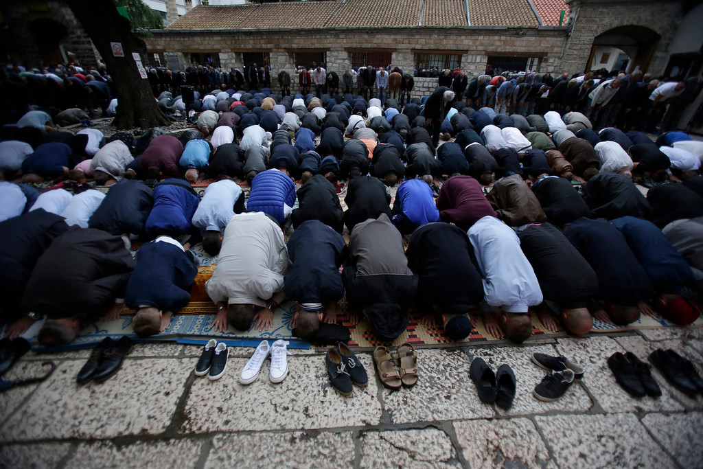 . Bosnian Muslims offer prayers during the first day of Eid al-Fitr, which marks the end of the holy fasting month of Ramadan at the Begova Mosque in Sarajevo, Bosnia early Friday, June 15, 2018. (AP Photo/Amel Emric)