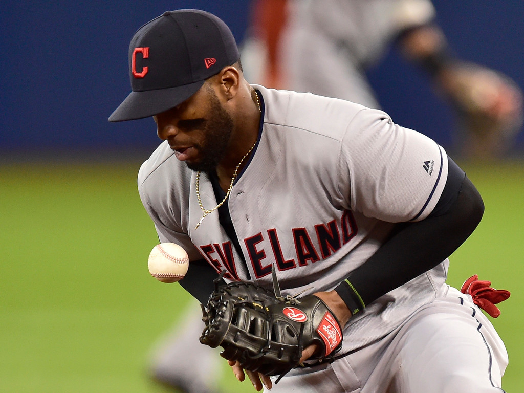 . Cleveland Indians first baseman Yandy Diaz takes a ball off his chest hit by Toronto Blue Jays Yangervis Solarte during second-inning baseball game action in Toronto, Sunday, Sept. 9, 2018. (Frank Gunn)