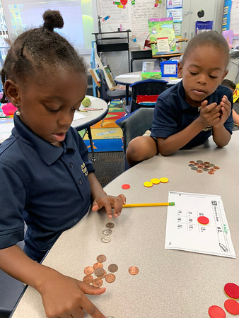 Three -in -a-Row Math Game to practice counting coins!