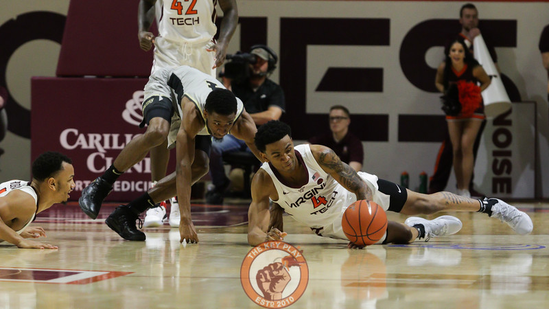 Nickeil Alexander-Walker dives for a loose ball in the second half. (Mark Umansky/TheKeyPlay.com)