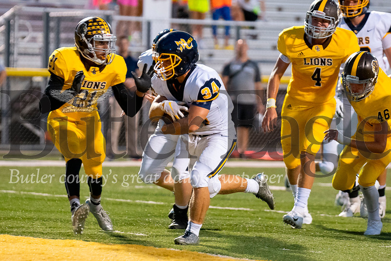 Mars running back Garrett Reinke (34) scores from 4 yards out past Greensburg Salem's Tyler Williams (21) in the final minute of the second quarter on Friday, Sep. 7, 2018 at Offutt Field in Greensburg. Mars defeated Greensburg Salem 35-7.  (Ken Reabe Jr | Western PA Sports Media)