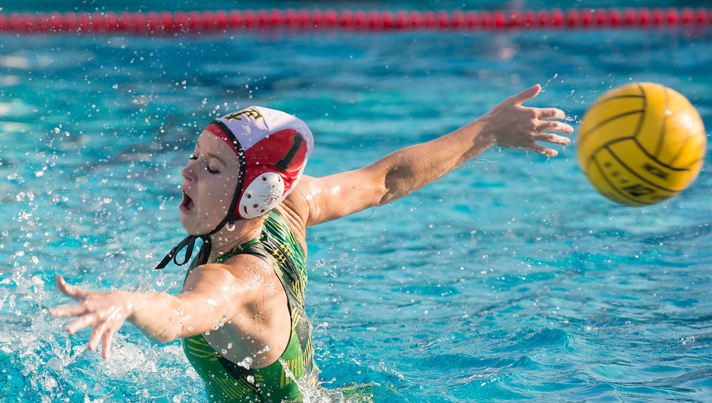 . Temple City High goalie Catherine Tereszczuk lunges for a La Serna High goal shot in the CIF-SS girls water polo first-round game at Whittier High Feb. 14, 2013.   (SGVN/Staff photo by Leo Jarzomb)
