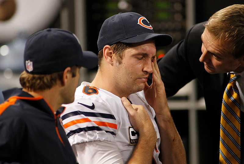 . Chicago Bears quarterback Jay Cutler, center, reacts as he sits on the bench after getting injured during the second half of an NFL football game against the Minnesota Vikings Sunday, Dec. 9, 2012, in Minneapolis. (AP Photo/Andy King)