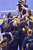 MORGANTOWN, WV - MARCH 8: WVU gymnast Zaakira Muhammad is congratulated by teammates following her performance on the balance beam during a dual meet March 8, 2015 in Morgantown, WV.