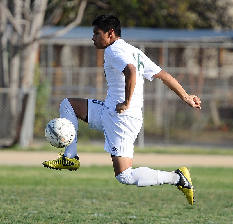 . March 4,2013. Canoga Park. Canoga Park #16 Rony Ventura gets control of the ball as Canoga took the win 2-0 over Coronado high during the first round of Southern California Div. II boys soccer regional playoffs   Photo by Gene Blevins/LA DailyNews