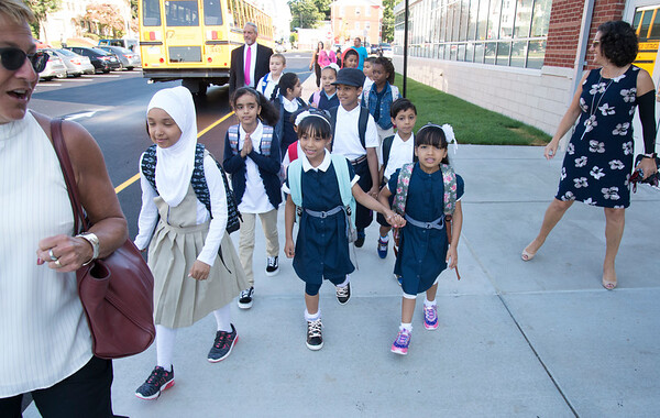 09/03/19 Wesley Bunnell | StaffrrSuperintendent of Schools Nancy Sarra leads the first bus full of students to their waiting areas as they arrive at Smalley School on for their first day on Tuesday September 3, 2019.