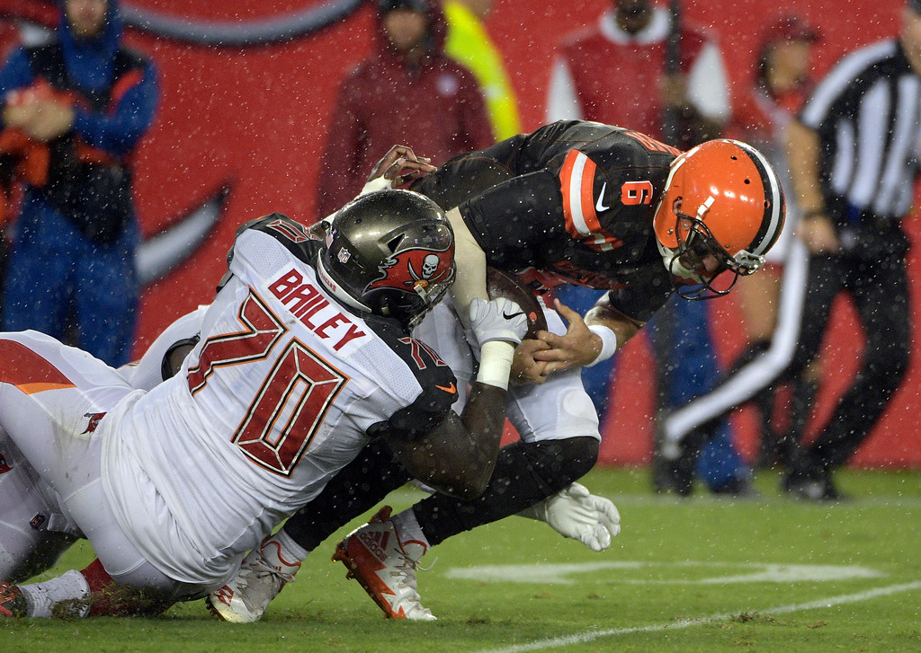 . Cleveland Browns quarterback Cody Kessler (6) is sacked by Tampa Bay Buccaneers defensive end Sterling Bailey (70) during the fourth quarter of an NFL preseason football game Saturday, Aug. 26, 2017, in Tampa, Fla. (AP Photo/Phelan Ebenhack)