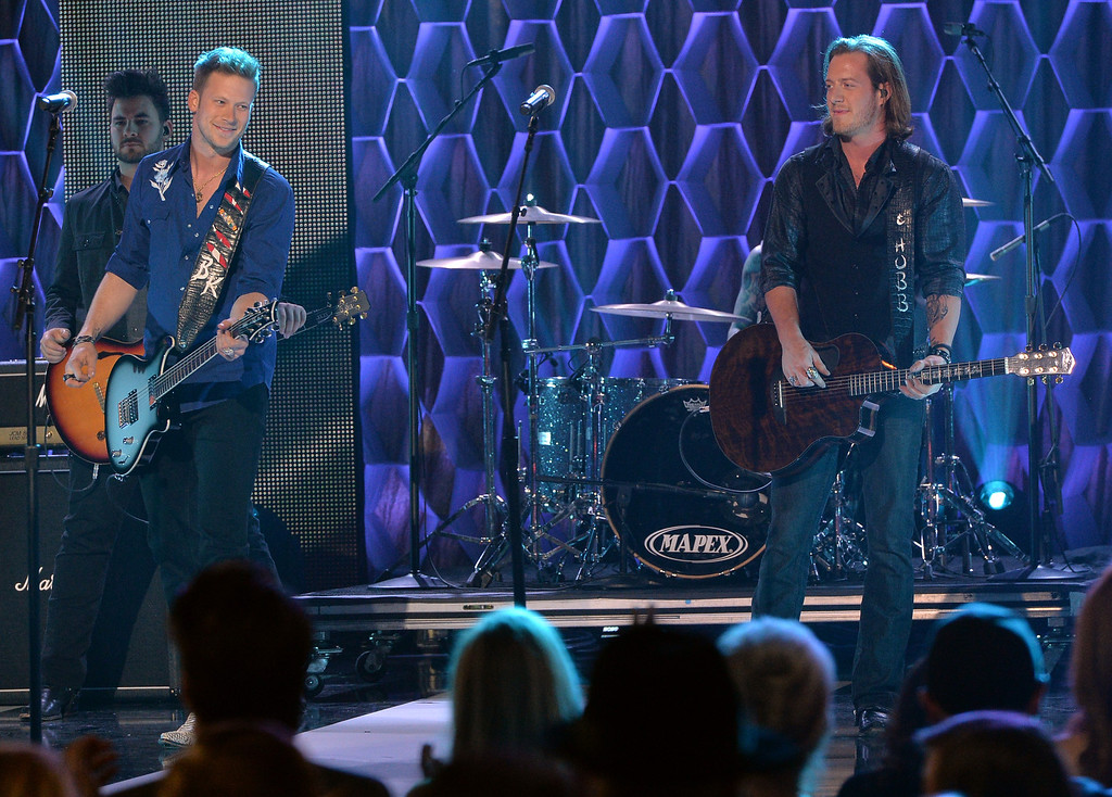 . Brian Kelley and Tyler Hubbard of Florida Georgia Line perform on CMT Artists Of The Year 2013 at Music City Center on December 3, 2013 in Nashville, Tennessee.  (Photo by Rick Diamond/Getty Images for CMT)
