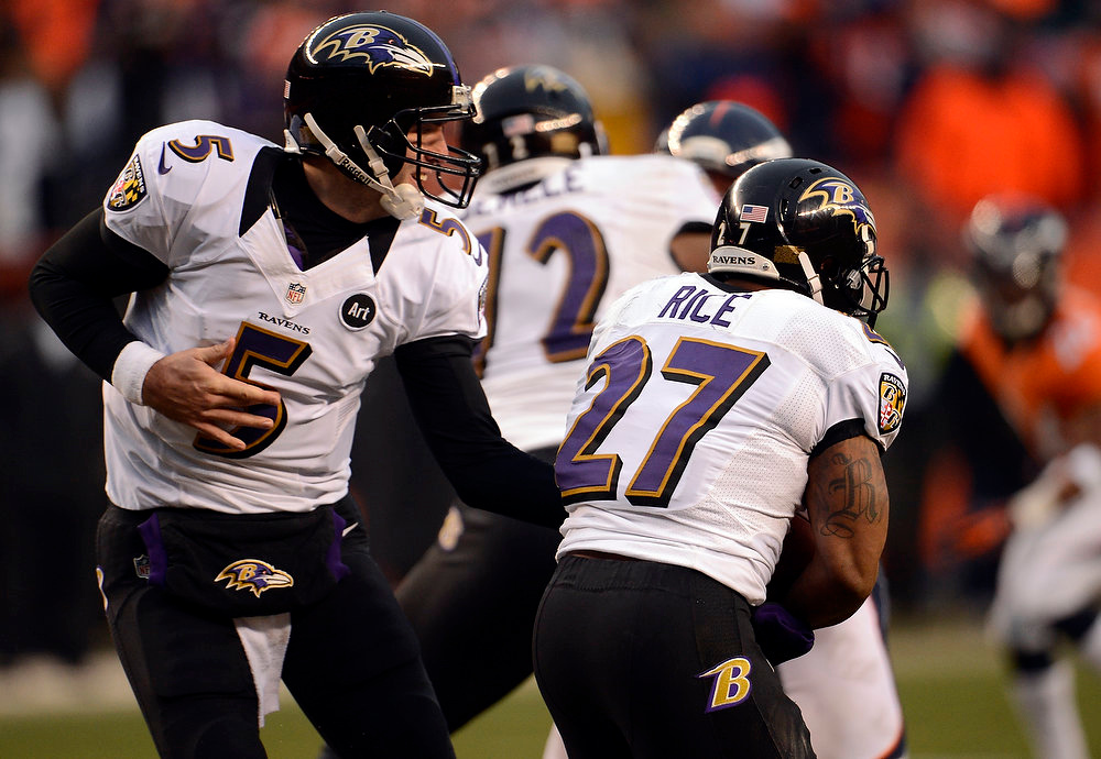 Description of . Baltimore Ravens quarterback Joe Flacco (5) hands off to Baltimore Ravens running back Ray Rice (27) during the third quarter.  The Denver Broncos vs Baltimore Ravens AFC Divisional playoff game at Sports Authority Field Saturday January 12, 2013. (Photo by John Leyba,/The Denver Post)