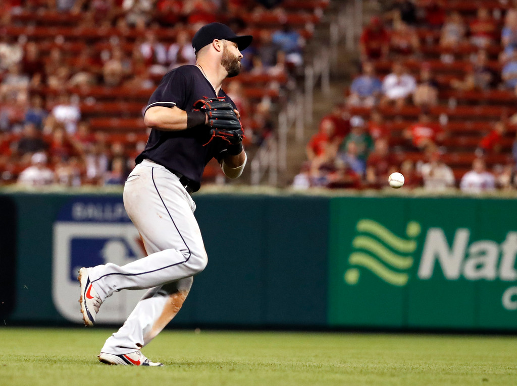 . Cleveland Indians second baseman Jason Kipnis chases a single by St. Louis Cardinals\' Harrison Bader after it bounced past during the eighth inning of a baseball game Monday, June 25, 2018, in St. Louis. The Cardinals Yadier Molina scored on the play. (AP Photo/Jeff Roberson)
