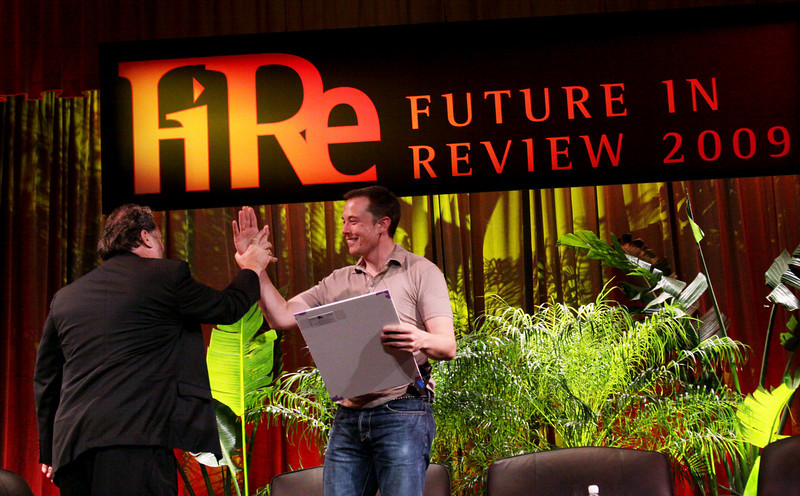 """Elon Musk (R), CEO of SpaceX and Tesla Motors, receives the first-ever """"FiRe Entrepreneur of the Year"""" award from host Mark Anderson, FiRe Chair and CEO of SNS"""