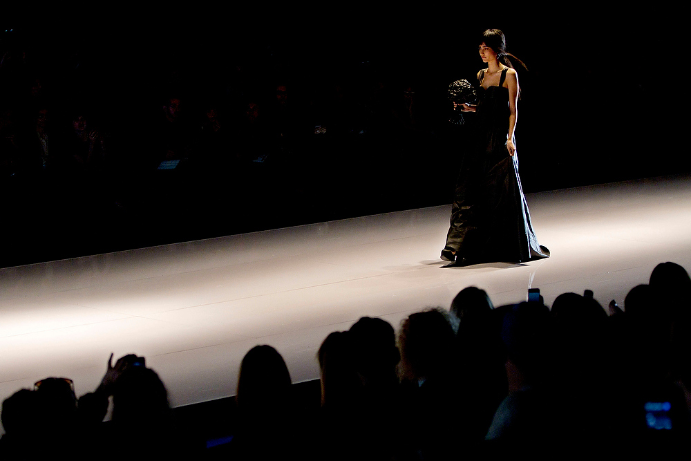 Description of . A model wears a creation by the Israeli designers Sample during a show at the Tel Aviv fashion week in Israel, Monday, Dec. 17, 2012. (AP Photo/Ariel Schalit)