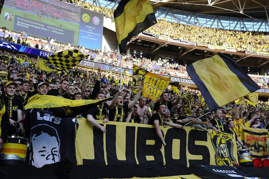 . Borussia Dortmund supporters in the crowd ahead of the UEFA Champions League final football match between Borussia Dortmund and Bayern Munich at Wembley Stadium in London on May 25, 2013   ADRIAN DENNIS/AFP/Getty Images