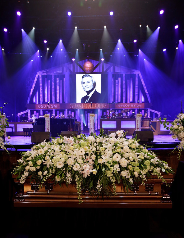. The casket for country music legend George Jones lies in the Grand Ole Opry House before his funeral on Thursday, May 2, 2013, in Nashville, Tenn.  (AP Photo/Mark Humphrey, Pool)