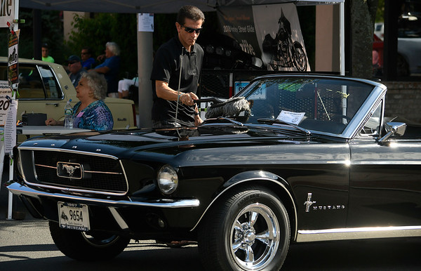 6/16/2018 Mike Orazzi | Staff Tom Fasolo wipes down his 1967 Mustang during The Ninth Annual Bill Englert Memorial Car Show, sponsored by TEAM Bristol, held on North Main Street Saturday evening in Bristol.