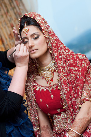 A few final make-up touches before the wedding. Photographed in Birmingham, Ala., by Kelli + Daniel Taylor Photography at the Hyatt Wynfrey Hotel.