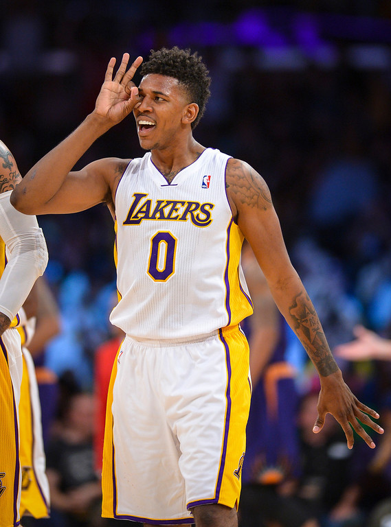 . <b>Nick Young</b>, small forward; averaged a team-leading 17.9 points in 28.3 minutes through 63 games <br /><br /> <b> Outlook</b>: His future appears uncertain since he will opt out of his $1.2 million player option in hopes of securing a longer and more lucrative deal here. Young is willing to take a reduced salary compared to what he could attract elsewhere so he can stay.   ( Photo by David Crane/Los Angeles Daily News )