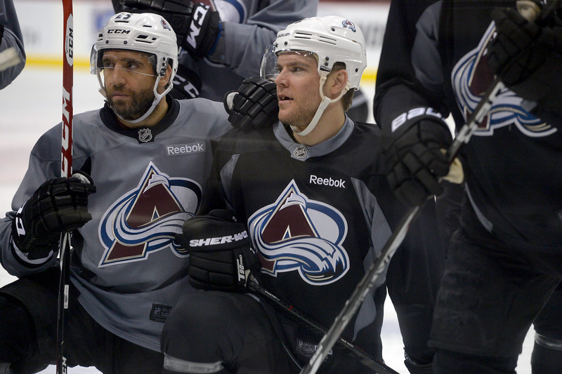 . Colorado Avalanche center Maxime Talbot (25) and Colorado Avalanche center Paul Stastny (26) listen to Colorado Avalanche head coach Patrick Roy during practice April 23, 2014 at Xcel Energy Center. (Photo by John Leyba/The Denver Post)