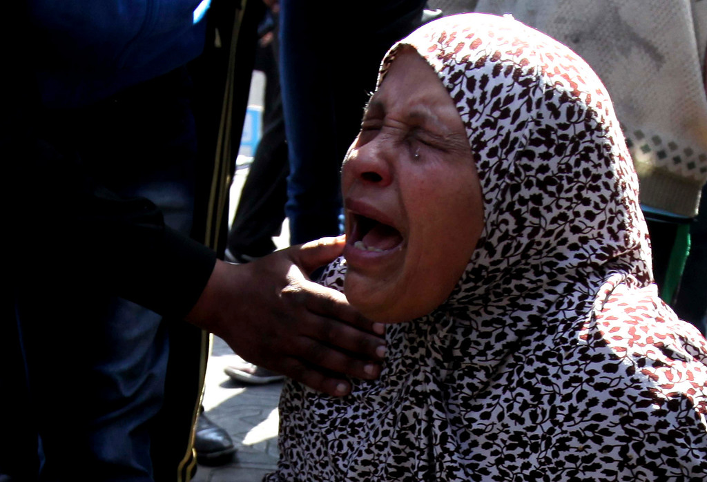 . A mother of one of the accused reacts after hearing the final verdict of the 2012 Port Said massacre, in Port Said city, 170 km (106 miles) northeast of Cairo, March 9, 2013. Egyptian protesters in Port Said untied moored speedboats used to supply shipping on the Suez Canal on Saturday, apparently hoping the boats would drift into the waterway and disrupt passing vessels, witnesses said. Port Said has been a flashpoint since January, with violent protests over death sentences given to local people in connection with a football stadium riot in which more than 70 people died last year. REUTERS/Mohamed Abd El Ghany