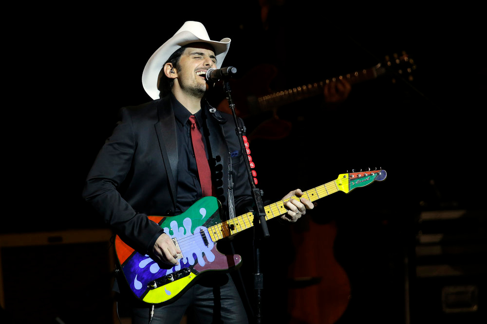 Description of . Brad Paisley performs during The Inaugural Ball at the Washignton convention center during the 57th Presidential Inauguration in Washington, Monday, Jan. 21, 2013. (AP Photo/Paul Sancya)