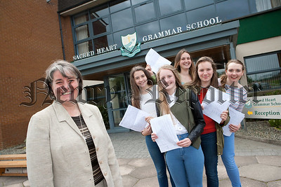 Sacred Heart Principal Sr Julie McGoldrick is pictured with students Meabh Monaghan, Jayne Hearty, Helen Monaghan, Aine Cassidy and Daisy Eccles who achieved 10A* at GCSE level. R1435005