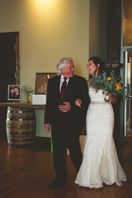 bride being escorted down aisle by father