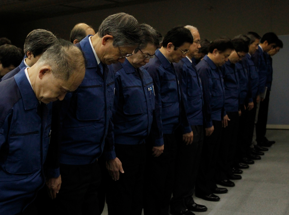 . Employees of Tokyo Electric Power Co. (TEPCO), the operator of the tsunami-crippled Fukushima Daiichi nuclear plant, take part in a moment of silence at 2:46 p.m. local time (0546 GMT) at TEPCO\'s headquarters in Tokyo March 11, 2013. Japan honours the victims of its worst disaster since World War Two on Monday: the March 11, 2011 earthquake, tsunami and nuclear crisis that killed almost 19,000 people and stranded 315,000 evacuees, including refugees who fled radiation from the devastated Fukushima atomic plant. REUTERS/Yuya Shino