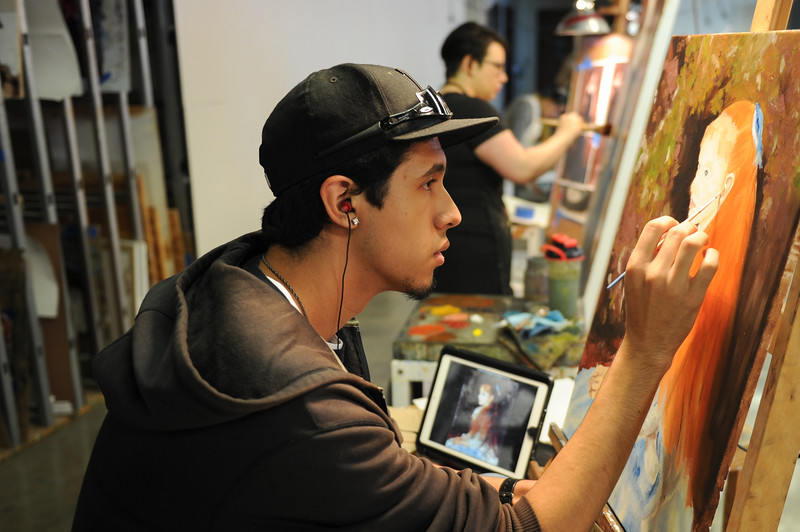 """Randy Salazar works on a master study titled """"Little Irene"""" by Renior."""