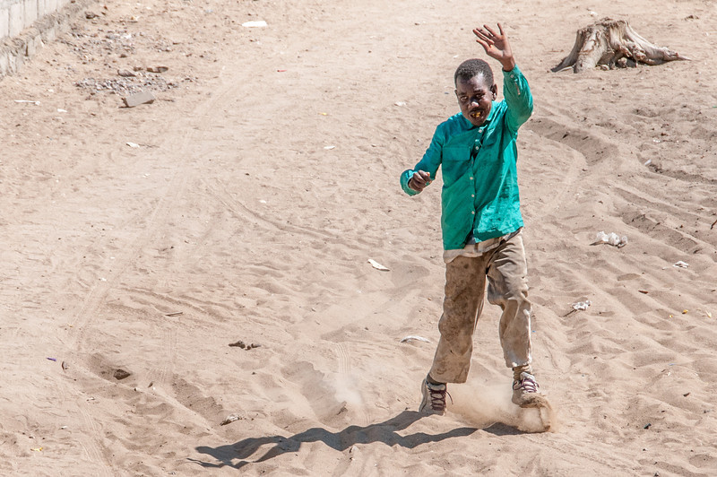 Kid playing in Lobito, Angola