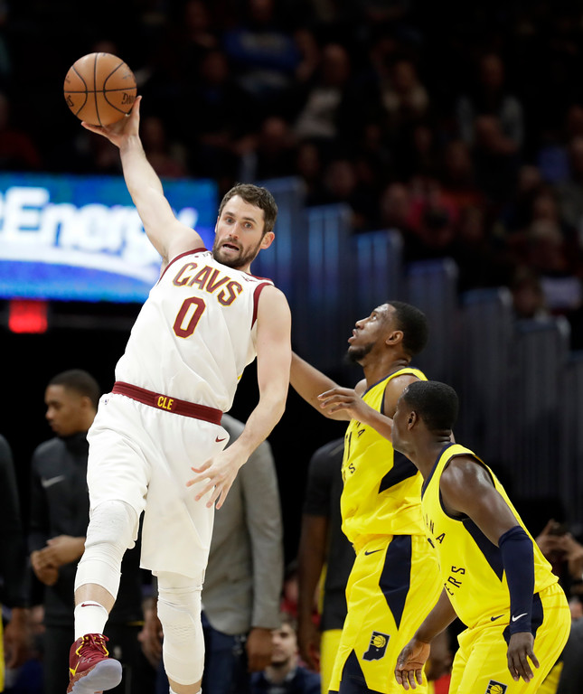 . Cleveland Cavaliers\' Kevin Love (0) grabs a rebound against the Indiana Pacers in the second half of an NBA basketball game, Friday, Jan. 26, 2018, in Cleveland. (AP Photo/Tony Dejak)