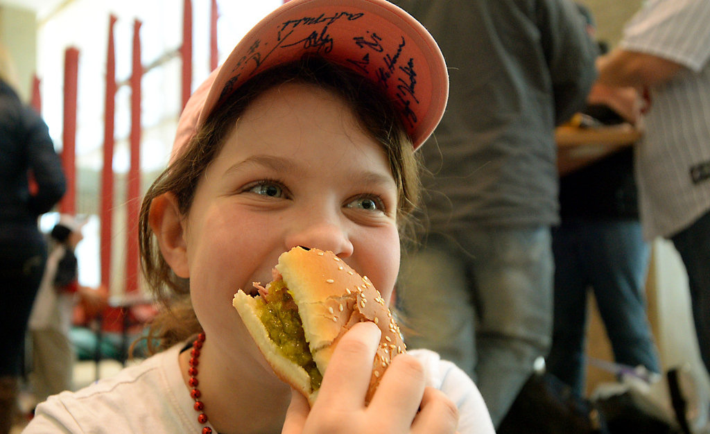 . Nine year-old Rylie Menden, from Buffalo, enjoys a hotdog with relish while attending Twinsfest with her family at Target Field, Saturday, January 25, 2014(Pioneer Press: John Autey)
