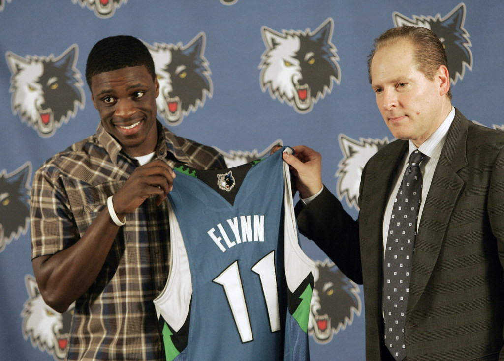 . David Kahn, right, presents a jersey to first round draft pick Jonny Flynn of Syracuse during a news conference at Target Center in Minneapolis on June 26, 2009.  (AP Photo/Jim Mone)